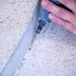 Fixing a crack in terrazzo flooring involves cleaning and preparing the crack for a full terrazzo floor restoration.